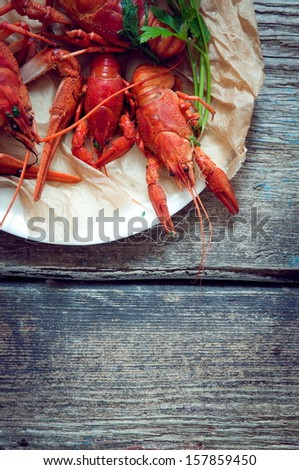 Boiled crayfish on a rustic  background - stock photo