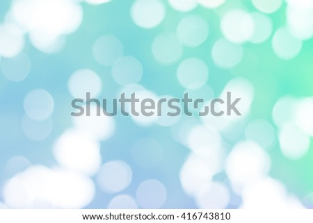 Bokeh on smooth pastel abstract gradient background. Fresh color wallpaper.