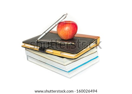 books and apple on white background - stock photo