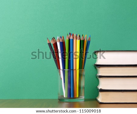 books and pencils on the desk - stock photo