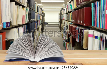 books in the shelf in library for education concept