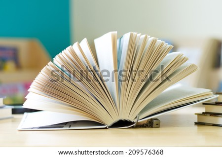books opened on the table - stock photo