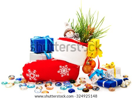 boot with gifts under the tree for Christmas