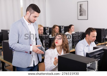 boss and european clerk at open space working area - stock photo