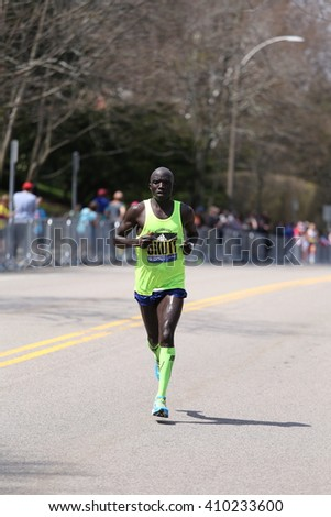 BOSTON - APRIL 18: Harbert Okuti with other elite men race up the Heartbreak Hill during the Boston Marathon April 18, 2016 in Boston. [public race]