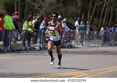 BOSTON - APRIL 18: Shingo Igarashi (Tokyo) with other elite men race up the Heartbreak Hill during the Boston Marathon April 18, 2016 in Boston. [public race]
