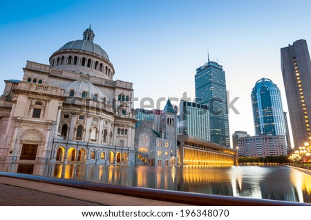 Boston downtown skyline panorama with skyscrapers over water at twilight MA - stock photo