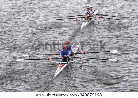 BOSTON - OCTOBER 18, 2015: Dolphin (top) and Don Rowing (Bottom) races in the Head of Charles Regatta Men's Master Doubles [PUBLIC RACE] - stock photo