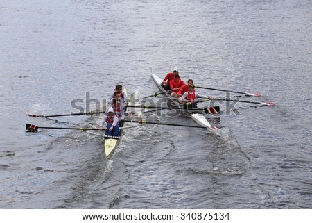 BOSTON - OCTOBER 18, 2015: Northeastern (left) and Cornell(right) collide in the Head of Charles Regatta Mens's Championship Fours [PUBLIC RACE] - stock photo
