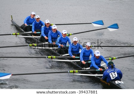 BOSTON - OCTOBER 18: Wellesley College women's rowing team competes in the Head Of The Charles Regatta on October 18, 2009 in Boston, Massachusetts. - stock photo