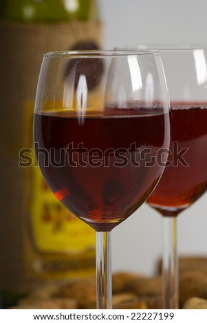 Bottle and two glasses with red wine