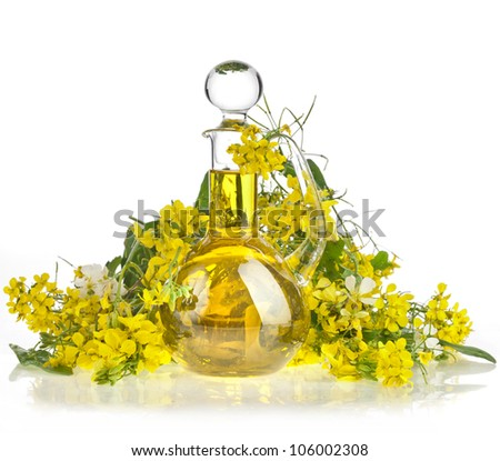 Bottle Decanter oil with Flower of a Rapeseed, Rape blossoms isolated  on white background - stock photo