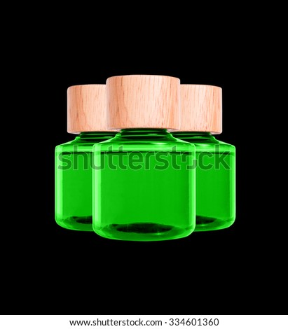 3 bottle in black background, equipment in bath room used in hotel, isolated. Green color.