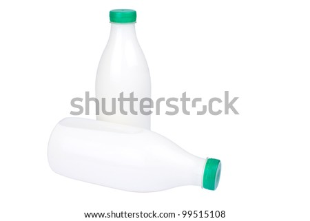 2 bottles of milk isolated on white background