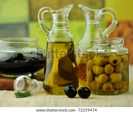 bottles of olive oil with black and green olives - stock photo
