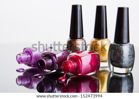 Bottles with nail polish over white - stock photo