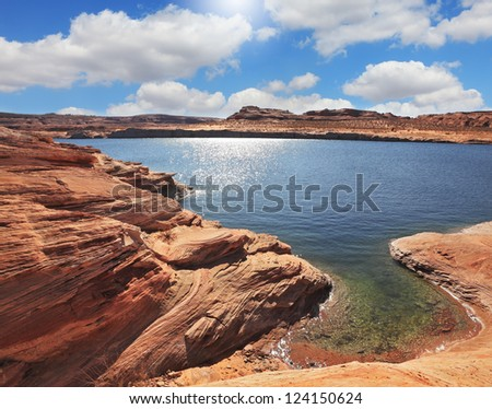 Bottling magnificent Lake Powell photographed by Fisheye lens.  The midday sun in the turquoise water bay - stock photo
