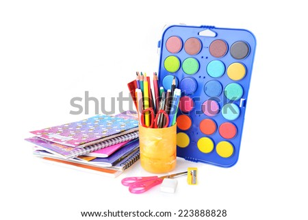 box with new watercolor paints, notebooks and other stationery facilities