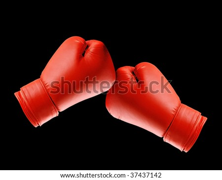 Boxing gloves isolated on black - stock photo