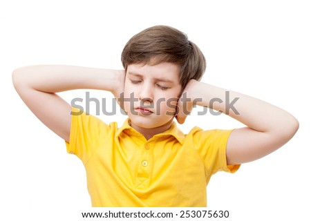 boy covering ears with hands eyes closed  - stock photo