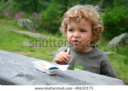 boy in a garden picnic on green grass