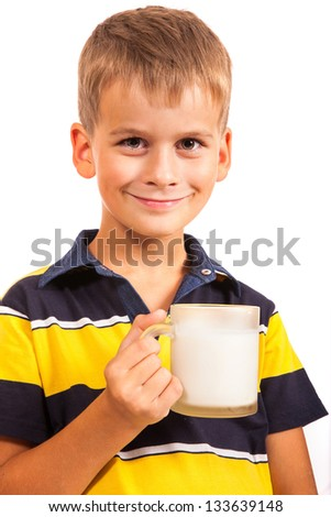 boy is drinking milk. Schoolboy is holding a cup of milk isolated on a white background - stock photo