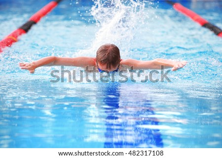 Boy swimming Butterfly in a race.
