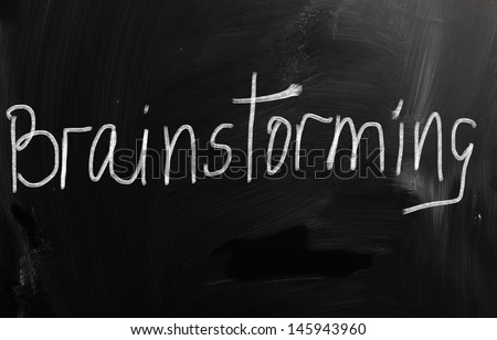 """Brainstorming "" handwritten with white chalk on a blackboard"