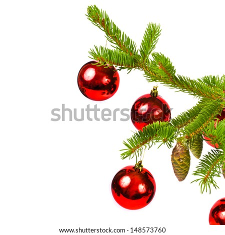 branch of a Christmas tree and three brilliant red balls and fir cones  isolated on white background - stock photo