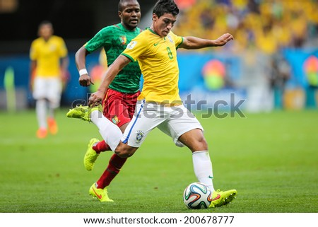 ??BRASILIA, BRAZIL - June 23, 2014: Paulinho of Brazil competes for the ball during the World Cup Group A game between Brazil and Cameroon at Estadio Nacional Mane Garrincha. No Use in Brazil.