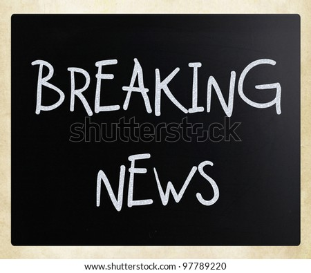 """Breaking news"" handwritten with white chalk on a blackboard - stock photo"