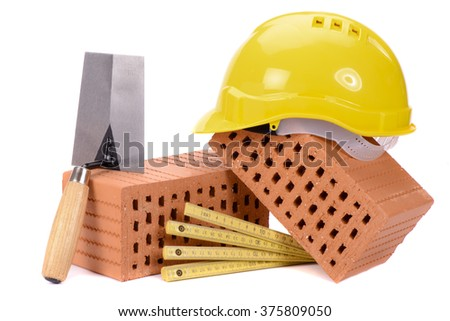 brick for house construction and tool - stock photo