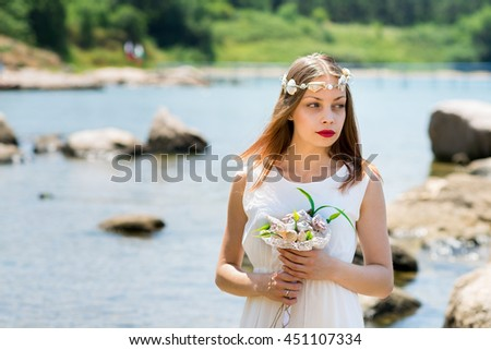 Bride with Wedding crown and bouquet of seashells