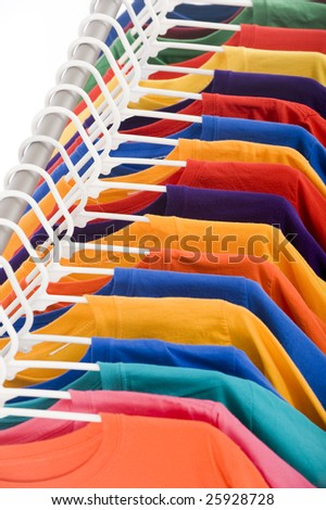 bright colored Tee Shirt hanging on a clothesline.