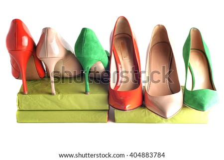bright, multicolored female shoes on high heels isolated on white background
