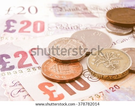 British Pounds banknotes and coins vintage - stock photo