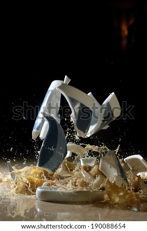 Broken coffee cup                   - stock photo