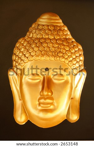 Bronze Buddha's face with black background - stock photo