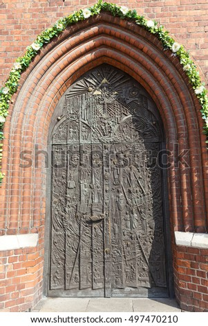 Bronze door of salvation history and important events in the history of Opole, Cathedral Basilica of the Holy Cross, Opole, Poland