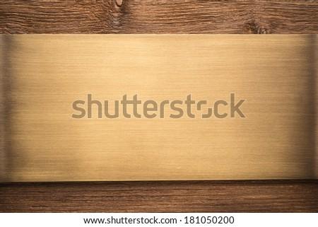 Bronze metal texture on wooden background   - stock photo