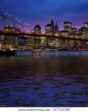 Brooklyn Bridge, East River and Manhattan at sunset with lights and reflections. New York - stock photo