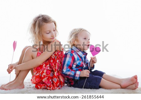 Brother and sister playing together - stock photo