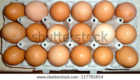 18 brown eggs - stock photo