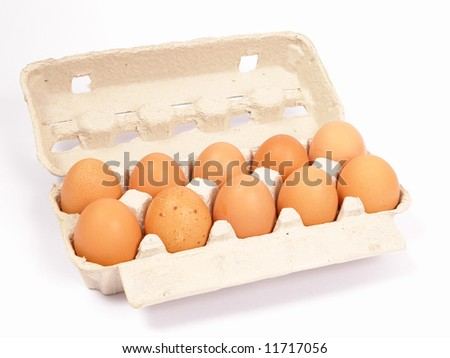 10  brown eggs in cardboard container - stock photo