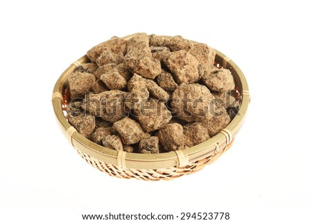 Brown Sugar in a bamboo basket  - stock photo