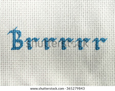 """Brrrrr"" cross stitched in blue on white"