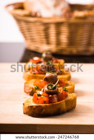Bruschetta topped with  anchovy   on  wooden cutting  - stock photo