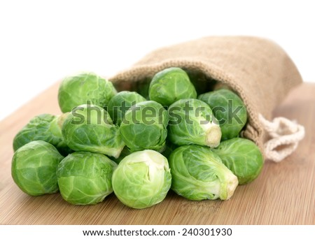brussel sprouts fall out bag on cutting board