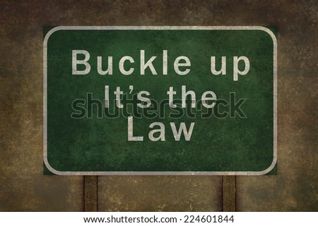 """Buckle up - its the law"" road side sign illustration, with distressed ominous background - stock photo"