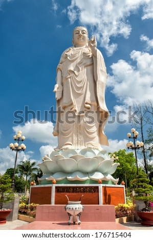 Buddha statue in the garden of the famous Vinh Trang Pagoda at My Tho City, Vietnam.